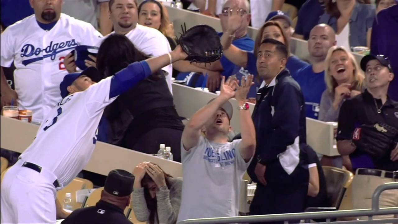 Fan fights with Adrian Gonzalez for a foul ball