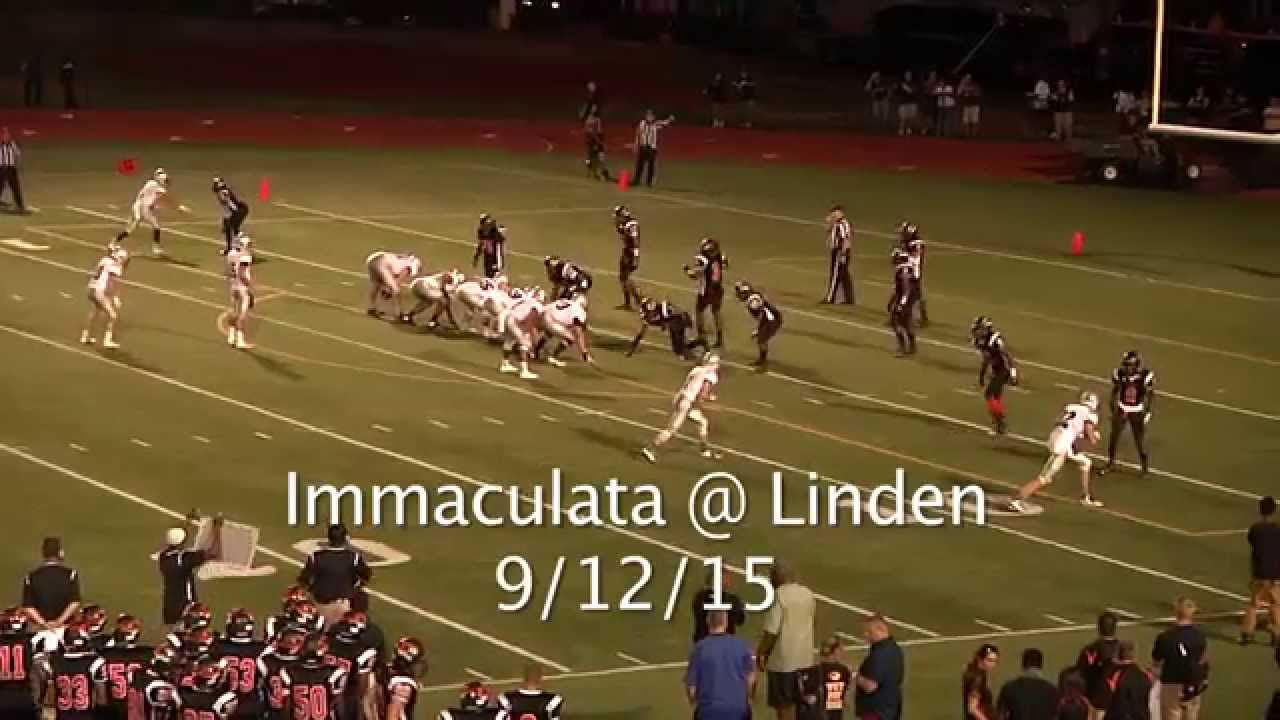 High school player rips off a player's helmet & hits him in the head with it