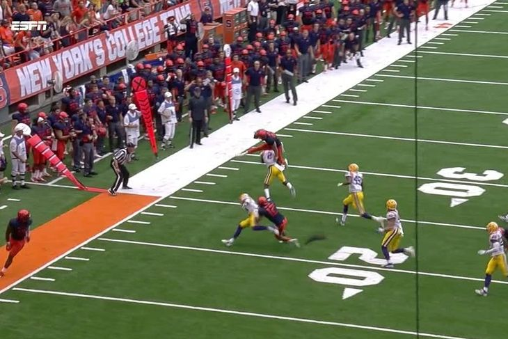 Syracuse punter hurdles defender & almost punches another