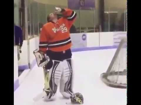 Virgina hockey goalie chugs a beer while on the ice & gets ejected