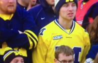 Angry Michigan fan flips off the camera