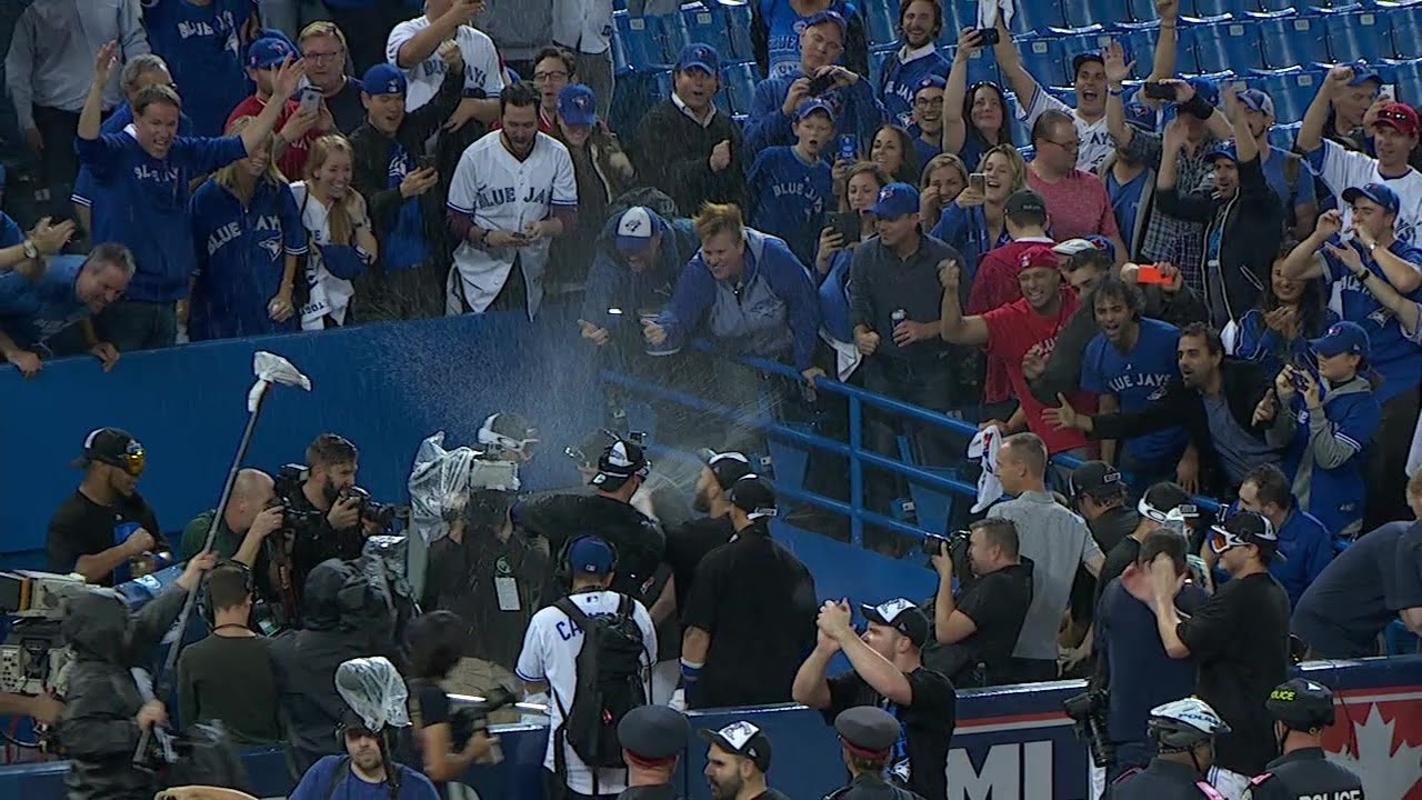Blue Jays players soak fans with champagne