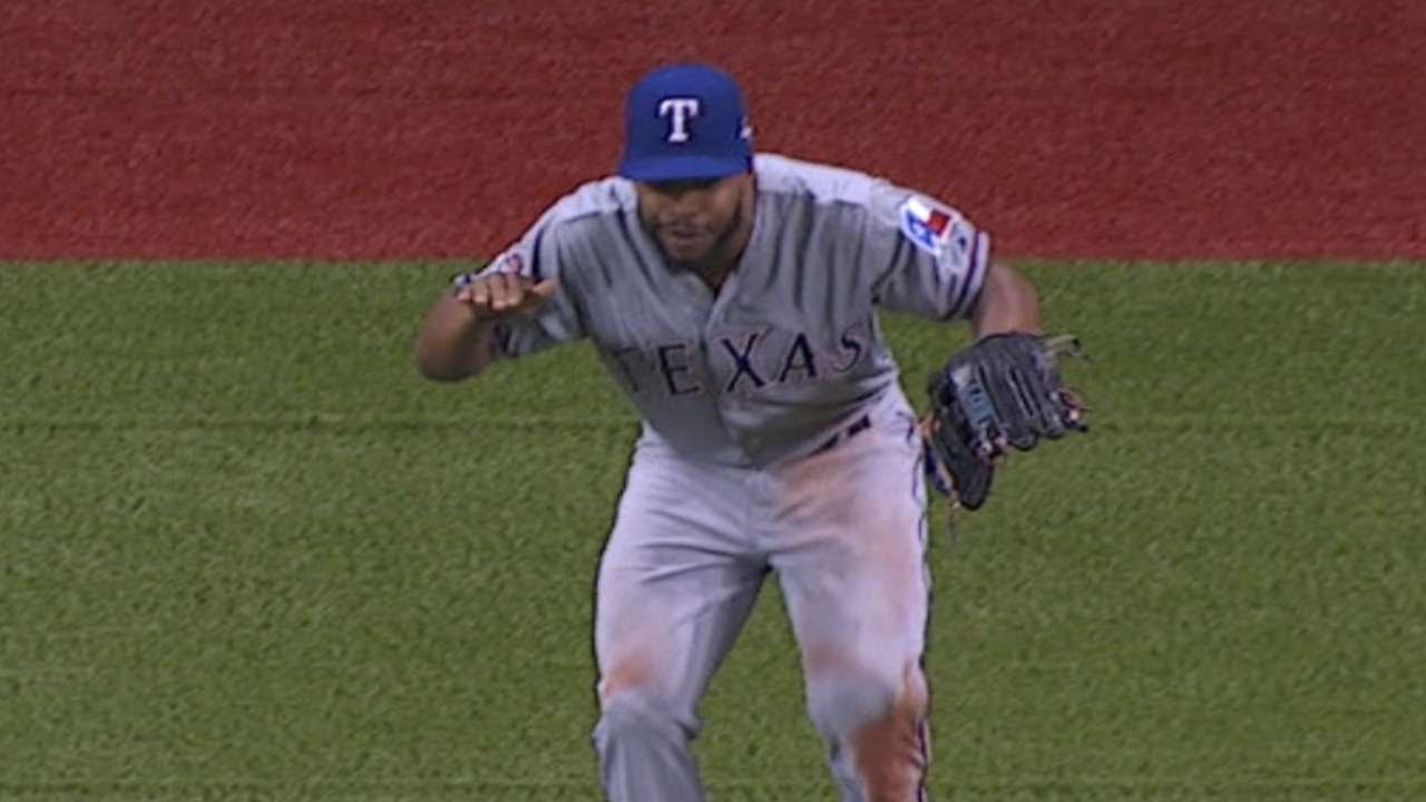 Delino DeShields does some housekeeping in the outfield