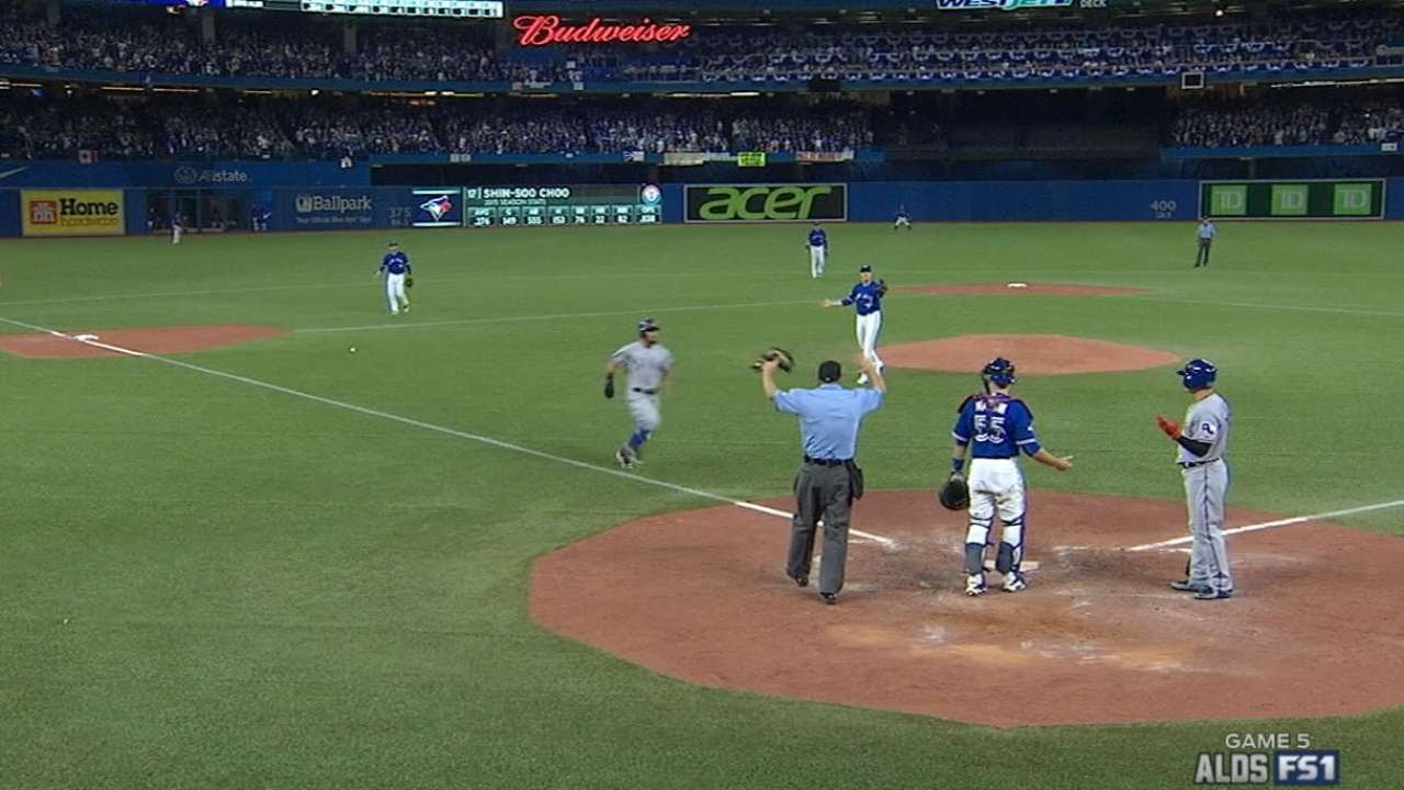 Insanity: Rougned Odor is awarded home after Martin throw hits bat