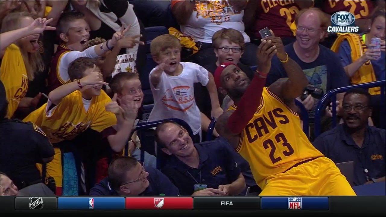 LeBron James uses fan's phone to take a selfie