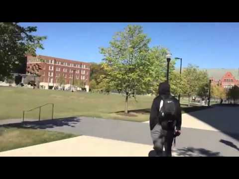 Ohio State students throw a jump pass over J.T. Barrett's head on campus