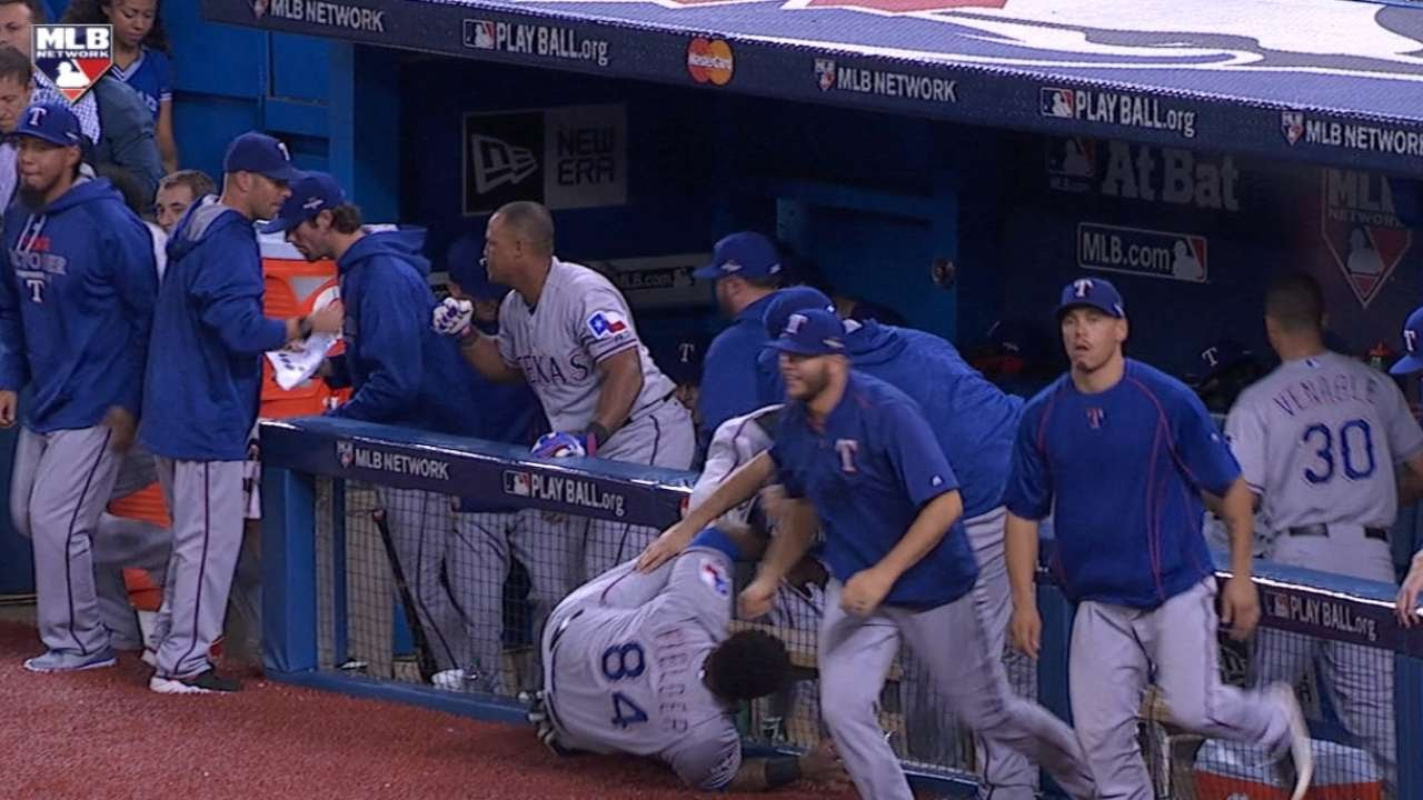 Prince Fielder takes a big mans tumble over the railing