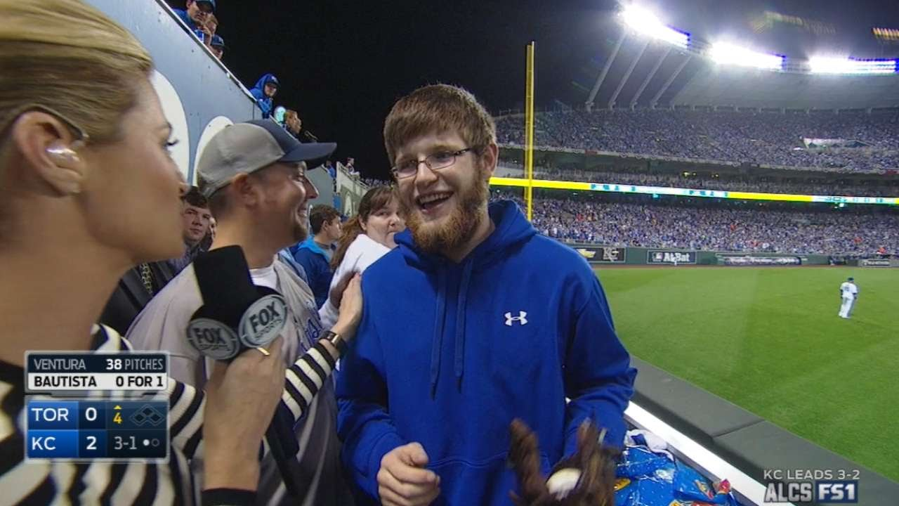 Royals fan discusses reaching for Moustakas' homer