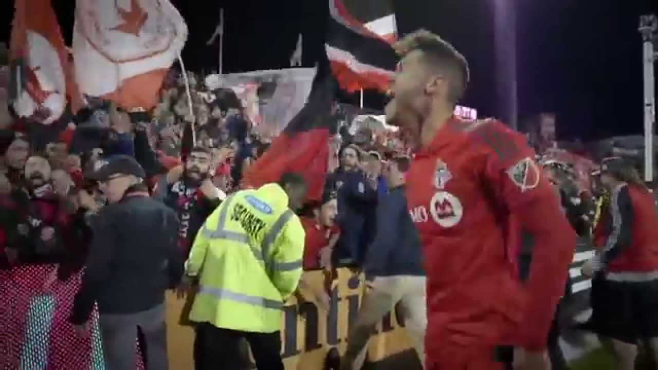 Toronto FC's Osorio Celebrating with supporters after making the MLS Playoffs