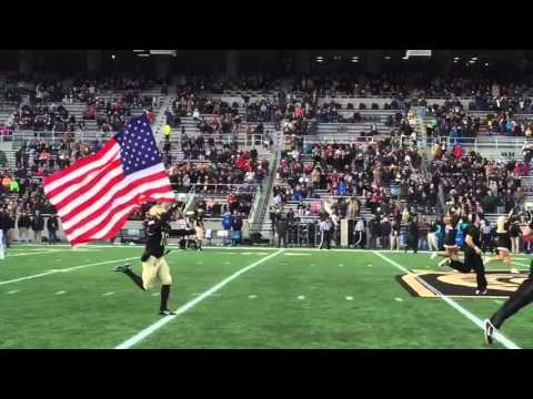 Army football takes the field carrying the French flag