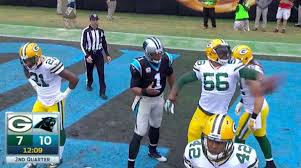 Julius Peppers plays keep away with Cam Newton's touchdown ball