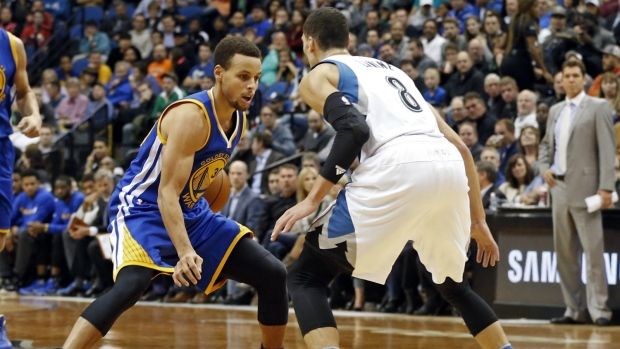 Steph Curry hits a 3-pointer even with Andre Miller getting a hand on it