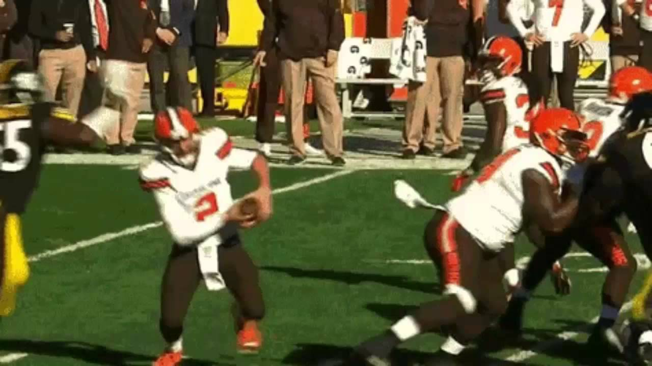 Johnny Manziel has head nearly twisted off by a vicious facemask