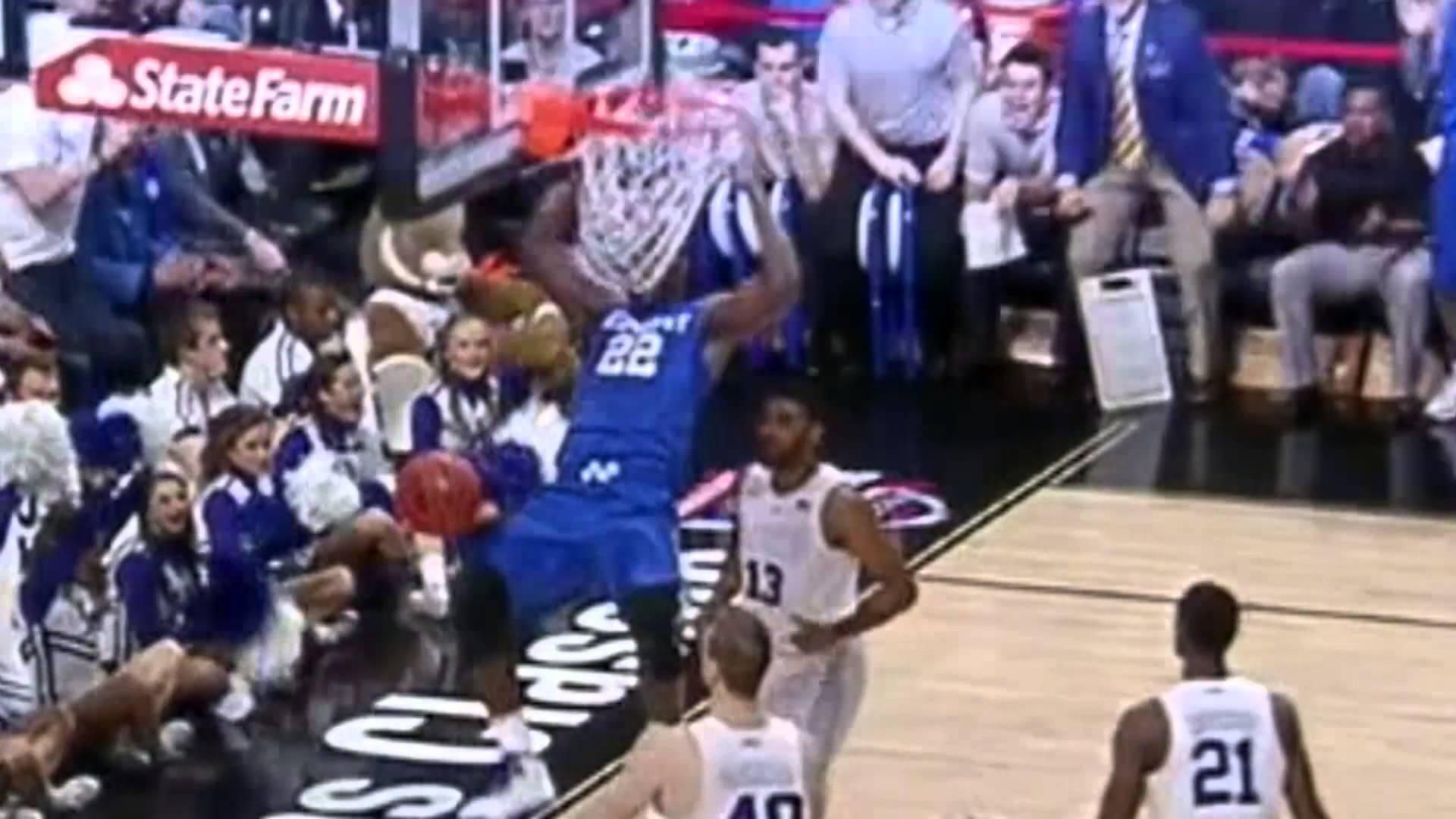 Kentucky basketball player Alex Poythress gets his teeth stuck in the net