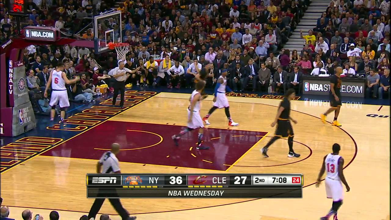 LeBron James rips off his jersey sleeves during the game