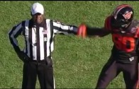 Virginia Tech DE Dadi Nicolas yells & makes contact with a ref