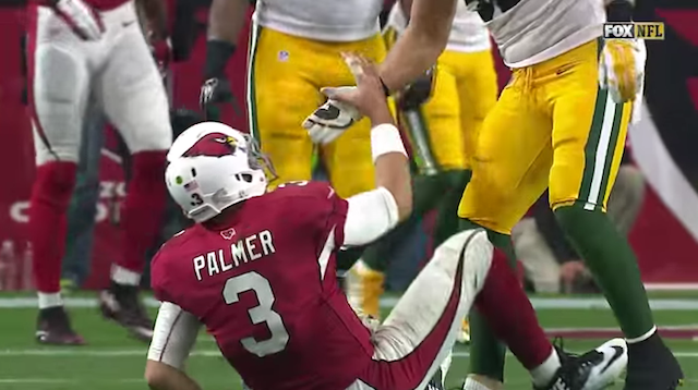 Clay Matthews pulls hand away on help up to Carson Palmer