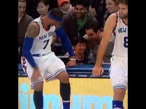 Carmelo Anthony makes a young New York Knicks fan smile
