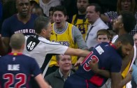 Nick Young gives a forearm to the face of Anthony Tolliver after foul