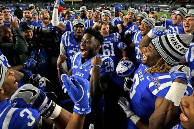 Duke celebrates Pinstripe Bowl victory in OT