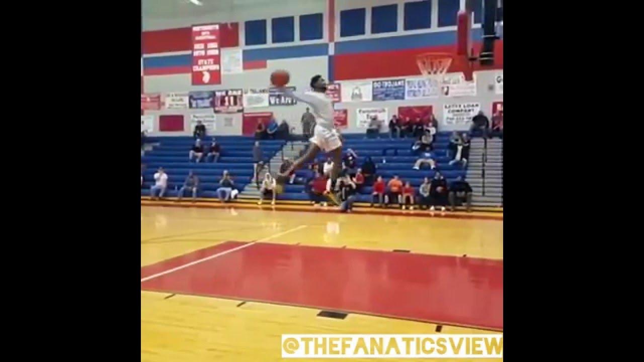High school senior JaShaun Smith throws down windmill from free throw line