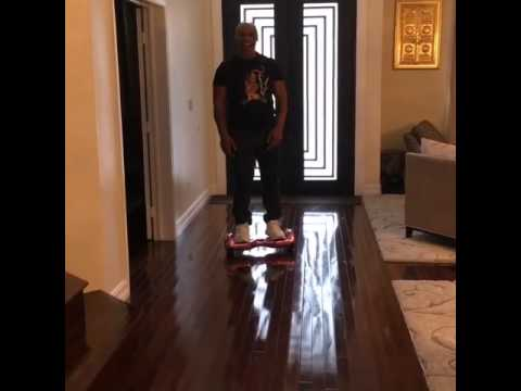 Mike Tyson takes a hard spill on his hoverboard
