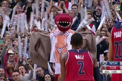 Toronto Raptors mascot does his best to distract John Wall