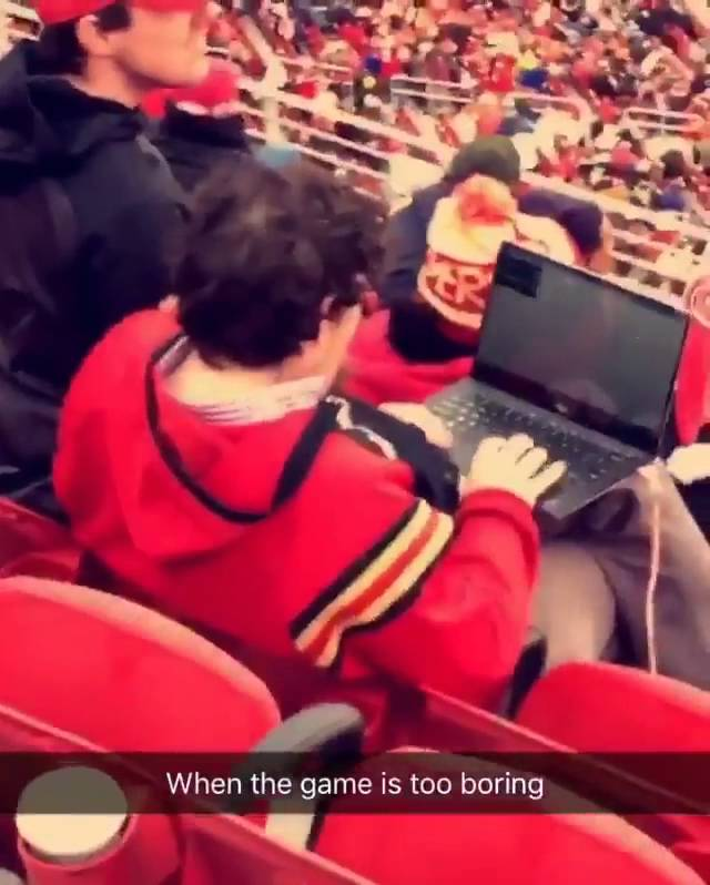 San Francisco 49ers fan pulls out his laptop instead of watching the game