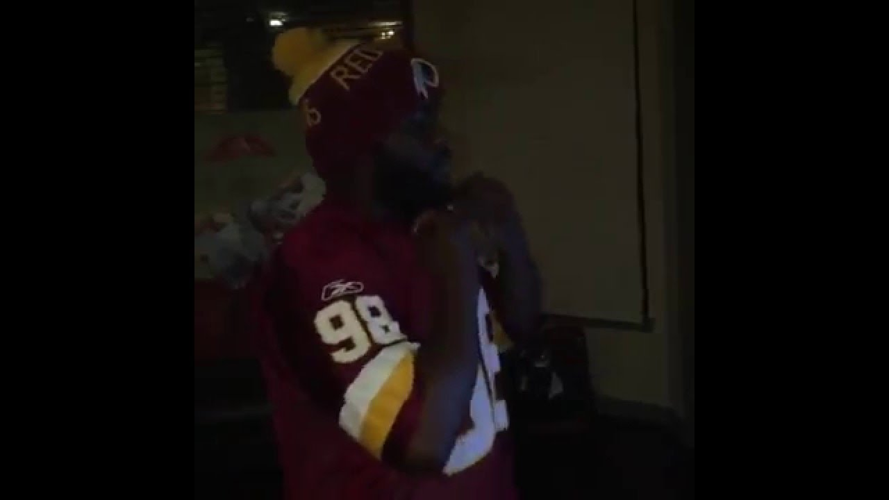 Washington Redskins fan rips his jersey after the Dallas Cowboys win