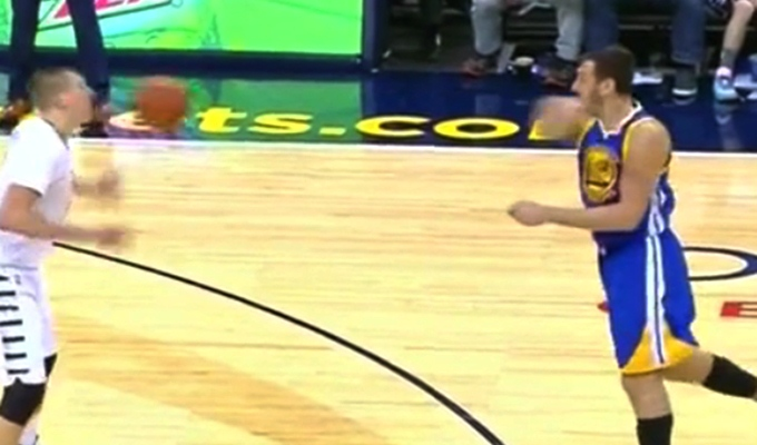 Andrew Bogut whips a basketball right off Nikola Jokic's face