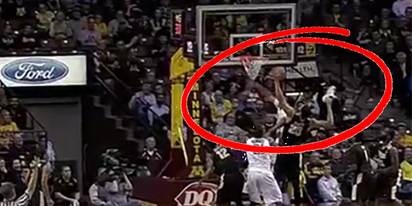 Purdue's A.J. Hammons grabs a rebound with his shoe in one hand