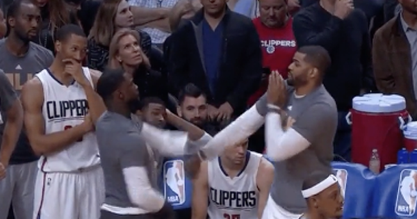 Lance Stephenson & Josh Smith slap box each other on the Clippers bench