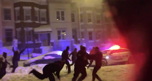 Washington D.C. cop with a beast football stiff arm in the snow storm