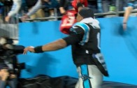 Cam Newton tries to steal Buccaneers jersey from fan but falls