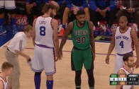 Amir Johnson swats Robin Lopez's shoe away