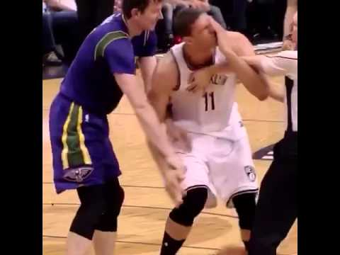 Brook Lopez gets poked in the eye by a ref trying to help