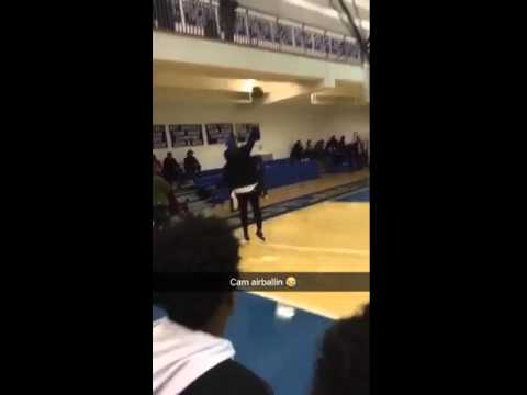 Cam Newton air balls a 3-pointer at a high school