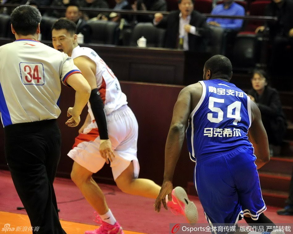 Former NBA player Jason Maxiell chases down a Chinese player to fight him