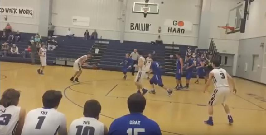 High School basketball player scores on a header tip in