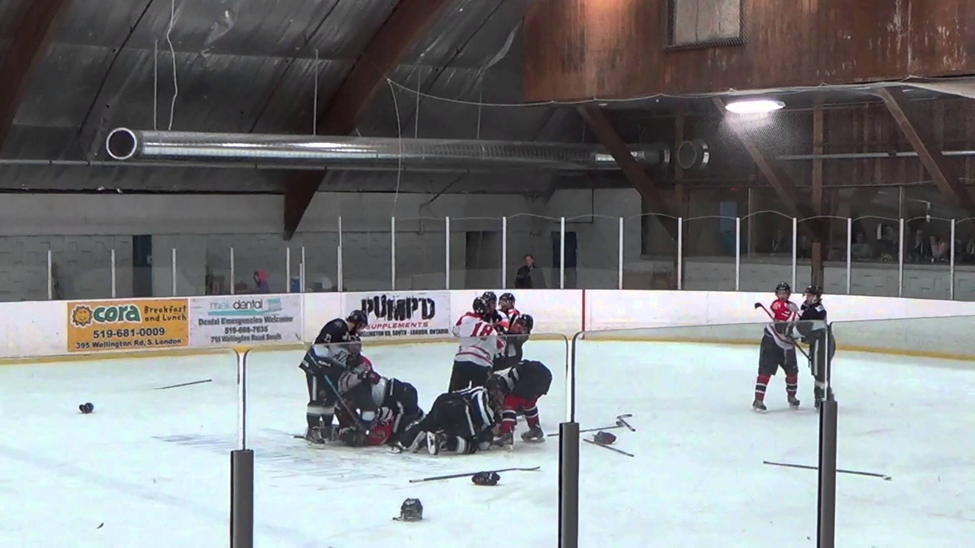 Massive hockey brawl breaks out involving players, refs & trainers