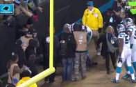Panthers fan falls out of the stands on Luke Kuechly's Pick 6
