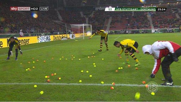 Dortmund fans throw hundreds of tennis balls onto pitch