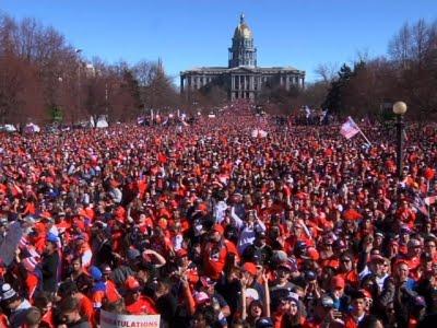 Broncos fans flood the streets of Denver for SB50 parade