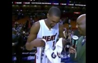 Chris Bosh covers camera with his towel after interview