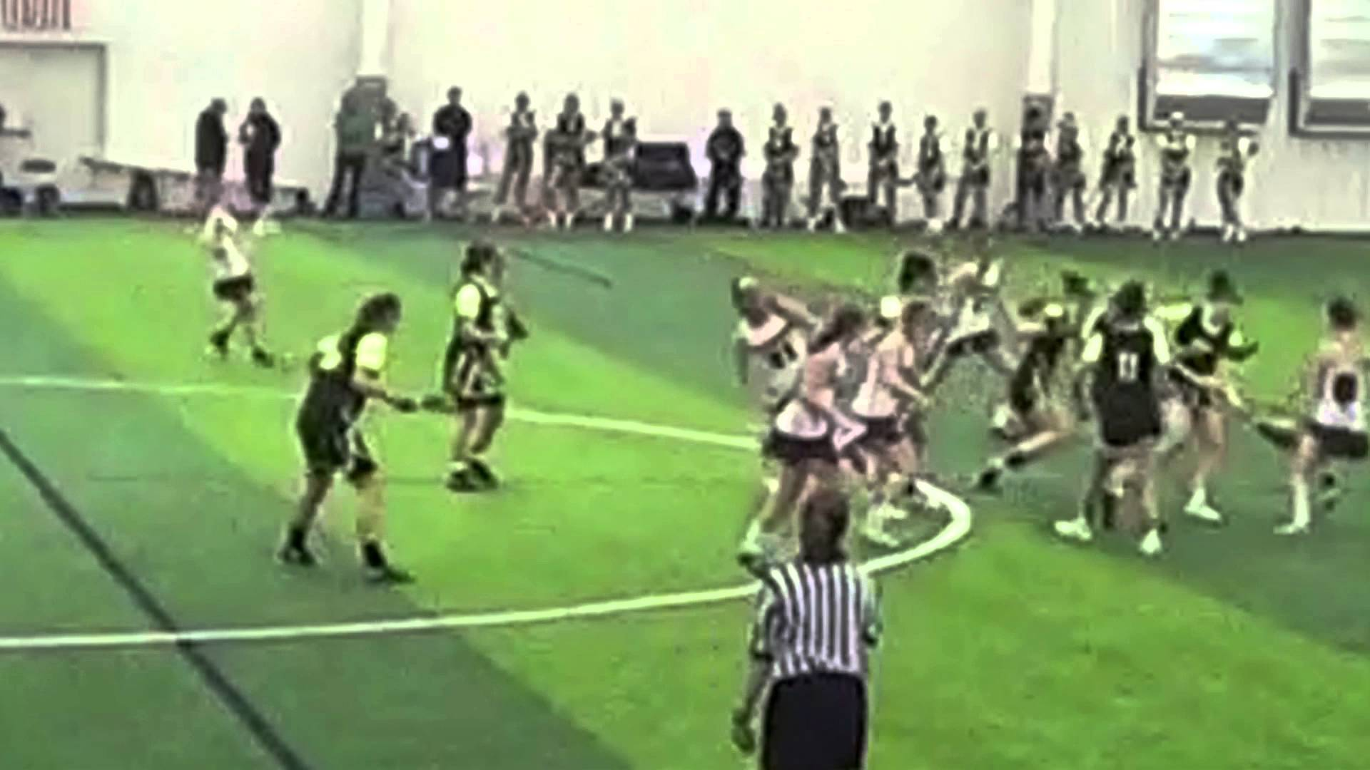 Female lacrosse player drills player 3 times in the face with stick