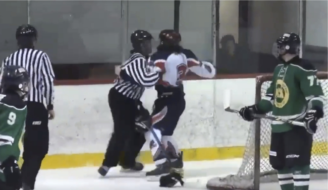 Hockey player arrested on the ice for spitting at ref