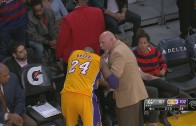 Kobe Bryant gets his finger popped back into place