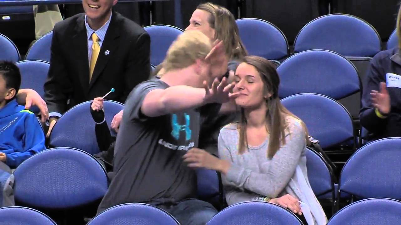 Savage: Basketball fan pump fakes a hug with his girlfriend