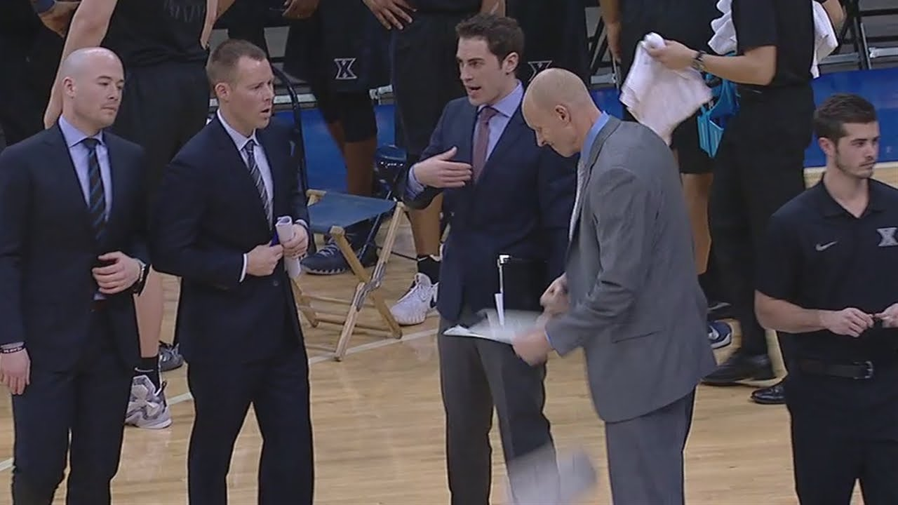Xaiver head coach Chris Mack punches his clipboard into two pieces