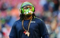 Marshawn Lynch steals a fans hat who was asking for an autograph